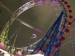 Thunder Dolphin going through the ferris wheel at Tokyo Dome City