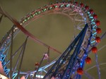 Thunder Dolphin going through the ferris wheel at Tokyo Dome City (the blur is the car)