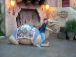 Yuko riding a camel at Disney Sea.