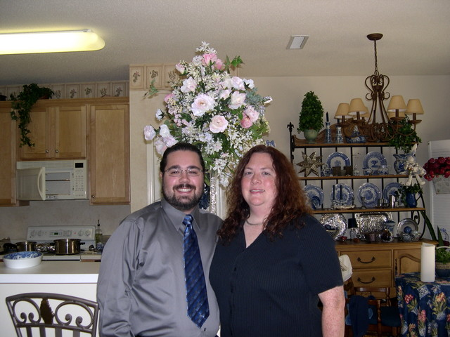 Ben and Cynthia and the huge flower arrangement